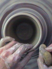 making clay pottery images compressing the rim